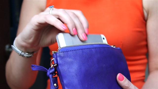 This chic leather wallet features a secret iPhone charger