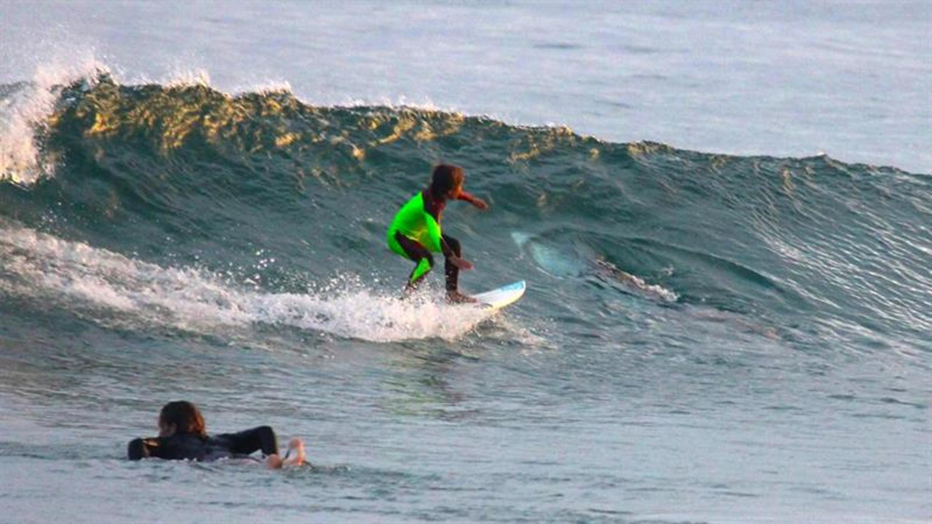 Shark Photobombs Unfazed 10-Year-Old Surfer