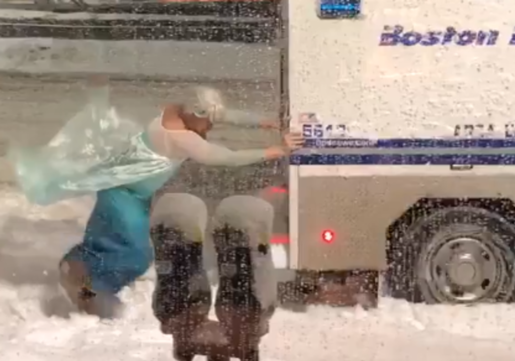 Man Dressed As Elsa From 'Frozen' Pushes Police Wagon Out Of Snow