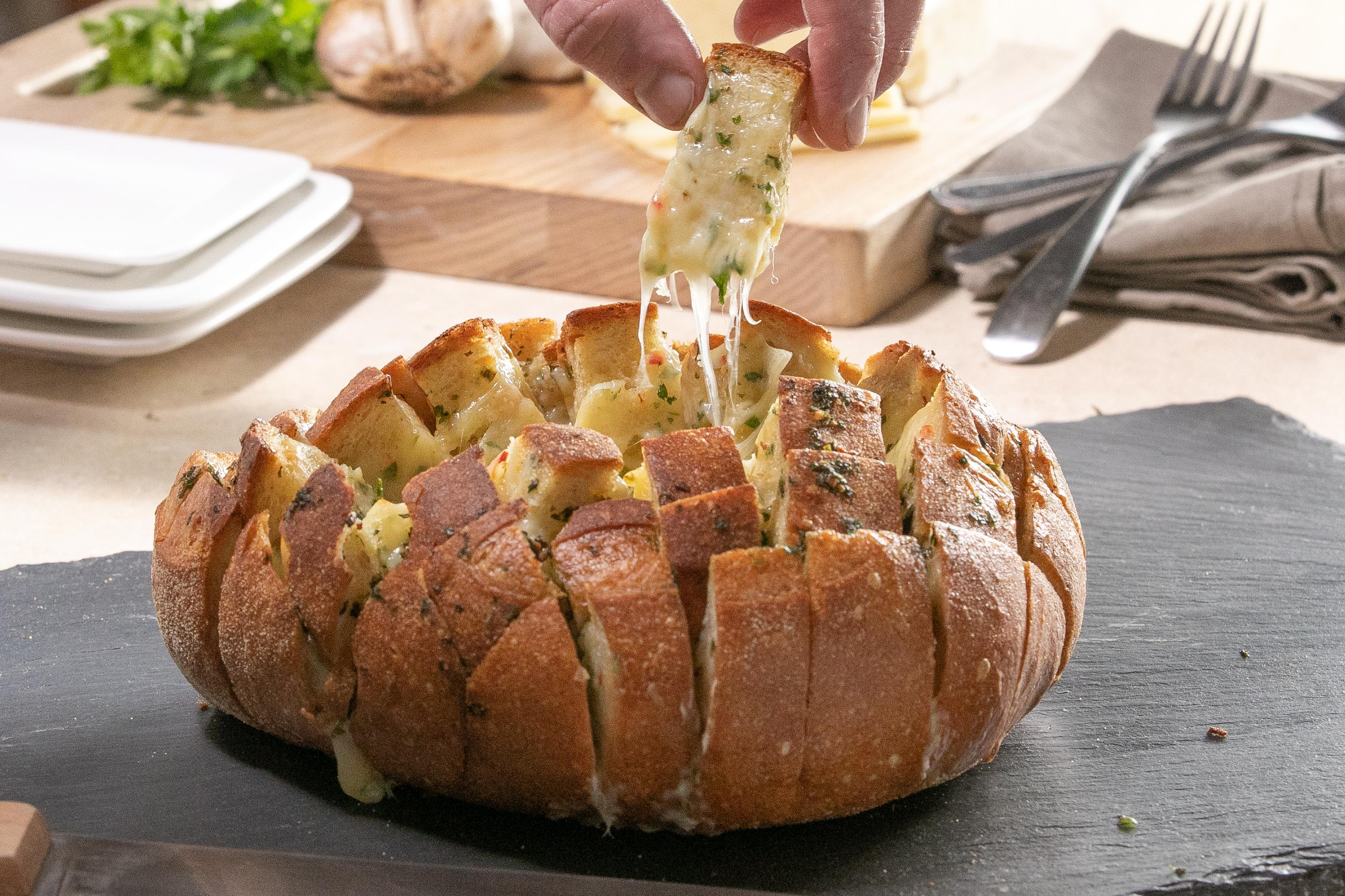 Try to stop yourself from eating this whole cheesy garlic pull-apart bread