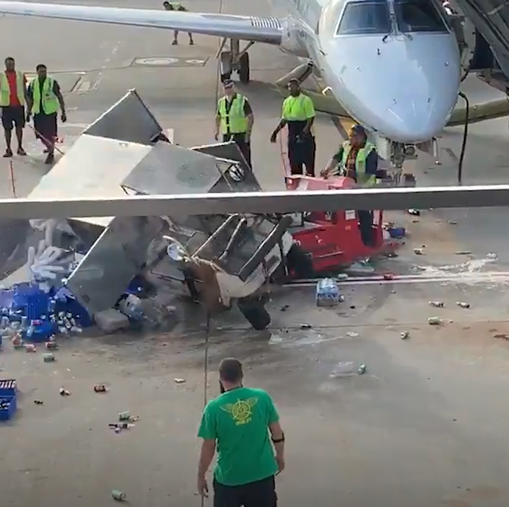 Airport catering truck goes berserk, nearly slams into plane